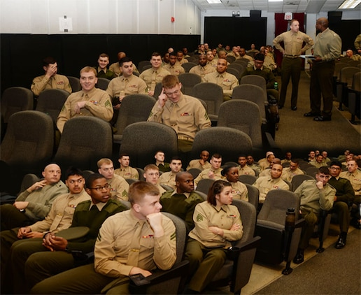 Marine Corps Logistics Command's active-duty service members participate in the Unit Marine Awareness and Prevention Integrated Training at the Base Theater, recently. The UMAPIT is a mandatory behavioral health training, which went into effect Jan 1. LOGCOM Marines also received training on the Marine Corps' equal opportunity and hazing policies.