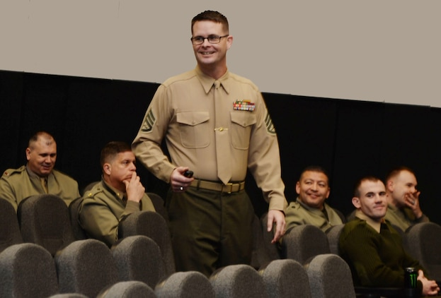 Staff Sgt. Benjamin Ford, company gunnery sergeant, Marine Corps Logistics Command, conducts a training session on the Marine Corps' policy on hazing to a group of LOGCOM Marines at the Base Theater, recently.  The activity was one in a three-part training, which also included the Marine Corps' Equal Opportunity Policy and the mandatory Unit Marine Awareness and Prevention Integrated Training.