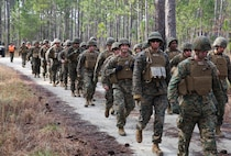 U.S. Marines and Navy Sailors with the 22nd Marine Expeditionary Unit march in a seven-mile unit hike at Marine Corps Base Camp Lejeune, N.C., Feb. 27, 2015. The unit conducted the hike to maintain unit readiness and build morale. (U.S. Marine Corps photo by Cpl. Caleb McDonald/Released)