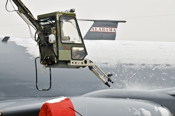 Maintainers  Master Sergeant Brian Champion, Airman First Class Zachory Bryant and Airman First Class Dathan Hudson from the 117th Air Refuelling Wing, Alabama Air National Guard work to clear ice and snow from KC-135R Stratotankers parked on the flight line. The planes are covered in a blanket of snow and ice as a rare winter storm pushes through north and central Alabama. (U.S. Air National Guard photo by: Senior Master Sgt. Ken Johnson/Released)