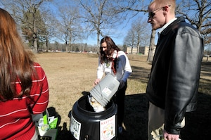 Annie Clements (center), with the ATA Information Technology and Systems Department, demonstrates how the new Earth Machine compost bins operate to Green Team members. She empties her personal compost into a bin located at the Carroll building and purchased through the Compost at AEDC Innovation Grant. Pictured with Clements are AEDC employees Donna Spry (left) and Craig Morris. (Photo by Jaqueline Cowan)