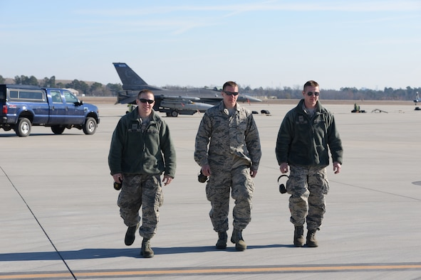 Airman 1st Class Nicholas Sirois, Staff Sgt. Michael Sirois and Airman 1st Class Patrick Sirois depart the flightline while particpating in Sentry Savannah 15-1, Feb 12, 2015, Savannah, Ga.  Sentry Savannah 15-1 is the Air National Guard's largest Fighter Integration, Air-to-Air, training exercise encompassing 4th and 5th generation aircraft.  (U.S. Air National Guard photo by Master Sgt. Ralph Kapustka/Released)