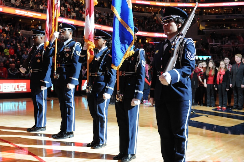 113th Wing Honor Guard members present the colors prior to the Washington Wizards home game against the Golden State Warriors, Feb. 24. The 113th Wing members were there as part of a community appreciation night honoring the D.C. Air National Guard during the Wizards game.  (Air National Guard photo by Master Sgt. Craig Clapper)