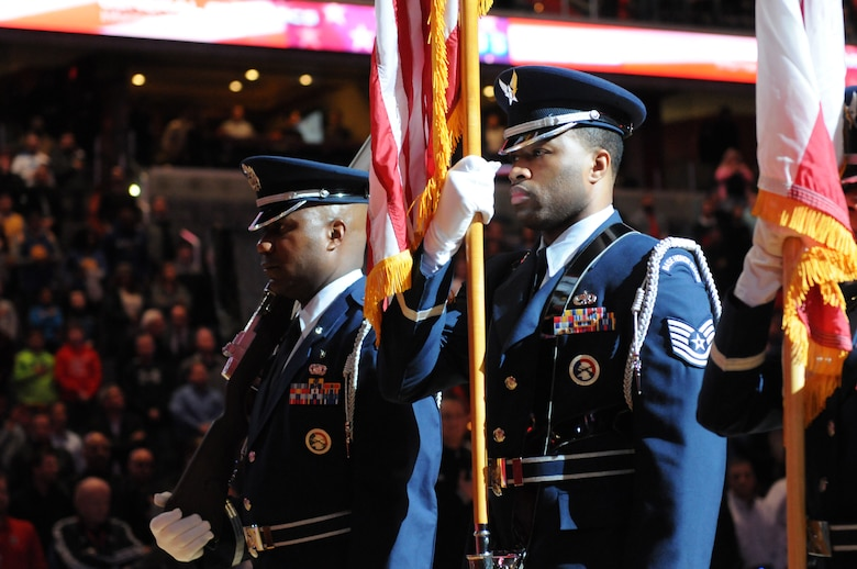 113th Wing Honor Guard members, Capt. Andre Slaughter and Tech. Sgt. Marcus Boykin, present the colors prior to the Washington Wizards home game against the Golden State Warriors, Feb. 24. The 113th Wing members were there as part of a community appreciation night honoring the D.C. Air National Guard during the Wizards game.  (Air National Guard photo by Master Sgt. Craig Clapper)