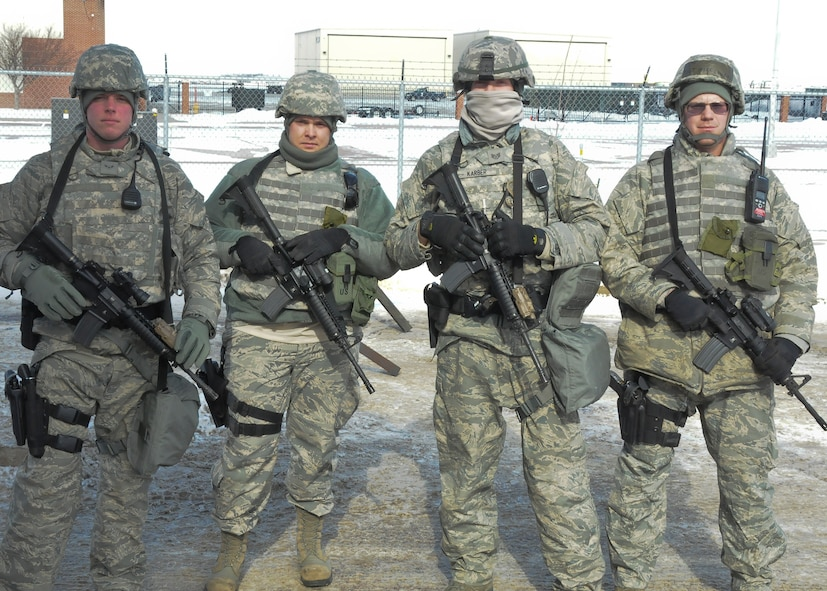 JOE FOSS FIELD, S.D. - Members of the 114th Fighter Wing Ready Augmentee Team pose for a photo during the Integrated Defense Exercise here January 26, 2015. The 114th FW RAT team's mission is to provide a group of base volunteers trained and ready to support security missions when the need arises. The RAT team can aid commanders in identifying, training, and tracking personnel to meet short-term augmentee needs for installation level exercises, contingencies, wartime, or emergency situation/scenarios. (National Guard photo by Staff Sgt. Luke Olson/Released)