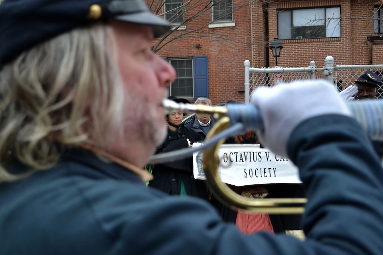 "The solemn sounds of ""Taps"" fill the air over 6th and Lombard Streets in