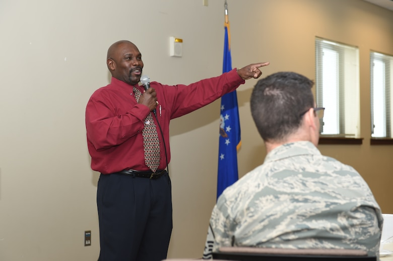 Vern L. Howard, Martin Luther King Jr. Colorado Holiday Commission chairman, speaks to Team Buckley members during a Black History Month presentation Feb. 26, 2015 at the chapel on Buckley Air Force Base, Colo. Howard spoke on the contributions African-Americans have made in American history while attendees sampled cultural dishes. (U.S. Air Force photo by Airman 1st Class Samantha Saulsbury/Released)