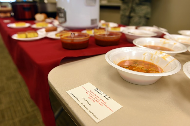 Food is displayed on tables during a Black History Month presentation Feb. 26, 2015, at the chapel on Buckley Air Force Base, Colo. Team Buckley members listened to a presentation by Vern L. Howard, Martin Luther King Jr. Colorado Holiday Commission chairman, while sampling the cultural food. (U.S. Air Force photo by Airman 1st Class Samantha Saulsbury/Released)
