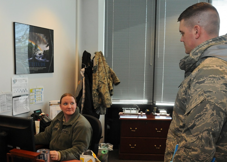 Master Sgt. Jason Mundt, 114th Inspector General program manager, questions Staff Sgt. Staci McKinney, 114th Logistics Readiness Squadron administrative support technician, about the Integrated Defense Exercise held at Joe Foss Field, Feb. 26, 2015. The IDE challenged the 114th Fighter Wing personnel on how they would react to a real world terrorist attack in the U.S. (National Guard photo by Staff Sgt. Luke Olson/Released)