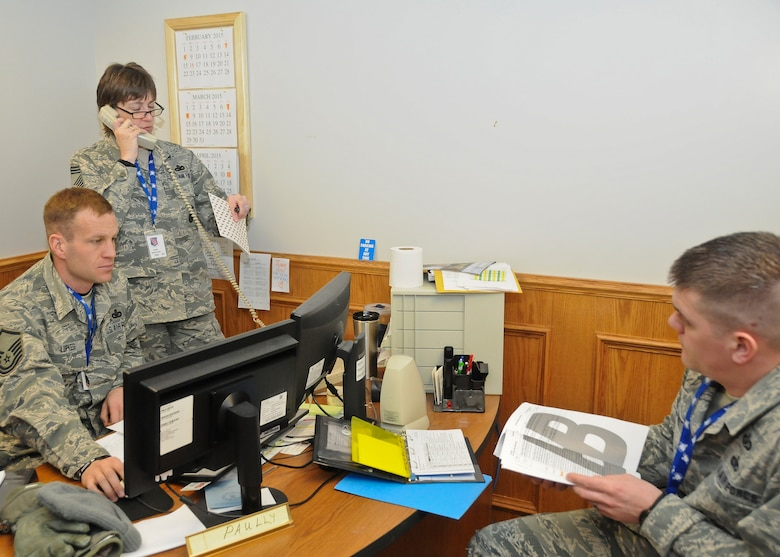 Chief Master Sgt. Jeanne Gacke, 114th Security Forces Squadron superintendent, coordinates an Integrated Defense Exercise with fellow Wing Inspection Team members at Joe Foss Field, Feb. 26, 2015. The IDE challenged the 114th Fighter Wing personnel on how they would react to a real world terrorist attack in the U.S. (National Guard photo by Staff Sgt. Luke Olson/Released)