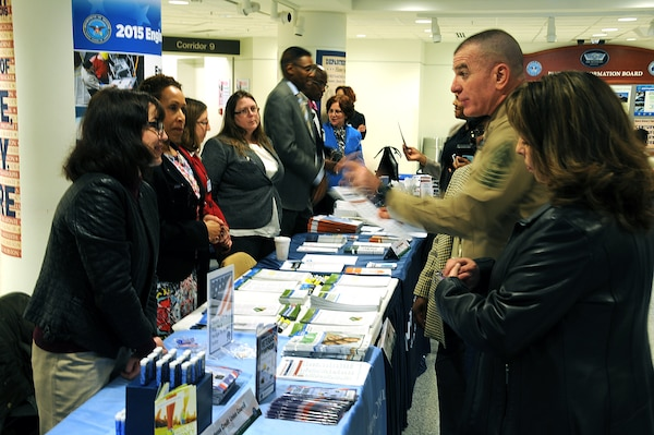 Marine Corps Sgt. Maj. Bryan Battaglia, senior enlisted advisor to the Chairman of the Joint Chiefs of Staff, and his wife, Lisa, visited the 2015 Military Saves Week Financial Fair at the Pentagon, Feb. 24, 2015. The annual fair is a  social marketing campaign to persuade, motivate and encourage military families to save money every month. DoD photos by Anthony Steele
