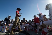 U.S. Marine Corps Staff Sgt. John L. Walker Jr., a drill instructor from Marine Corps Recruit Depot San Diego, speaks with Semper Fidelis All-American football players [West Team], concluding the team's first practice at Santa Ana Stadium in Santa Ana, Calif., Dec. 31, 2014. In preparation for the Semper Fidelis All-American Bowl, Walker and other drill instructors spend time with the players to share their Marine Corps' experiences with the student-athletes. The bowl, featuring 99 players from across the country, will be nationally televised live from the StubHub Center in Carson, Calif., at 6 p.m. (PST) on Jan. 4, 2015, on Fox Sports 1. (U.S. Marine Corps photo by Sgt. Tyler J. Bolken/Released)