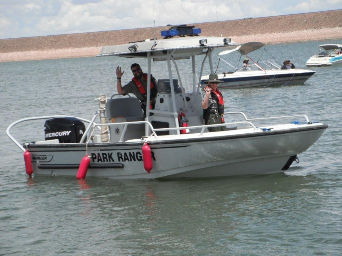 """2014 District Photo Drive entry. Photo by Lauren Boyer, May 25, 2014. """"Conchas Lead Park Ranger Valerie Mavis and Ranger Michael Vollmer assist the public during a boating event at Conchas Lake, N.M."""""""