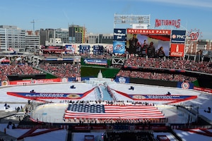 Service members take part in a flag ceremony on the ice in Nationals Park, Washington, D.C., before the start of the 2015 Bridgestone NHL Winter Classic hockey game between the Washington Capitals and Chicago Blackhawks, Jan. 1, 2015. The National Hockey League paid tribute to the U.S. Armed Forces during pre-game and in-game festivities. The Capitals beat the Blackhawks, 3-2. DoD Photo by EJ Hersom