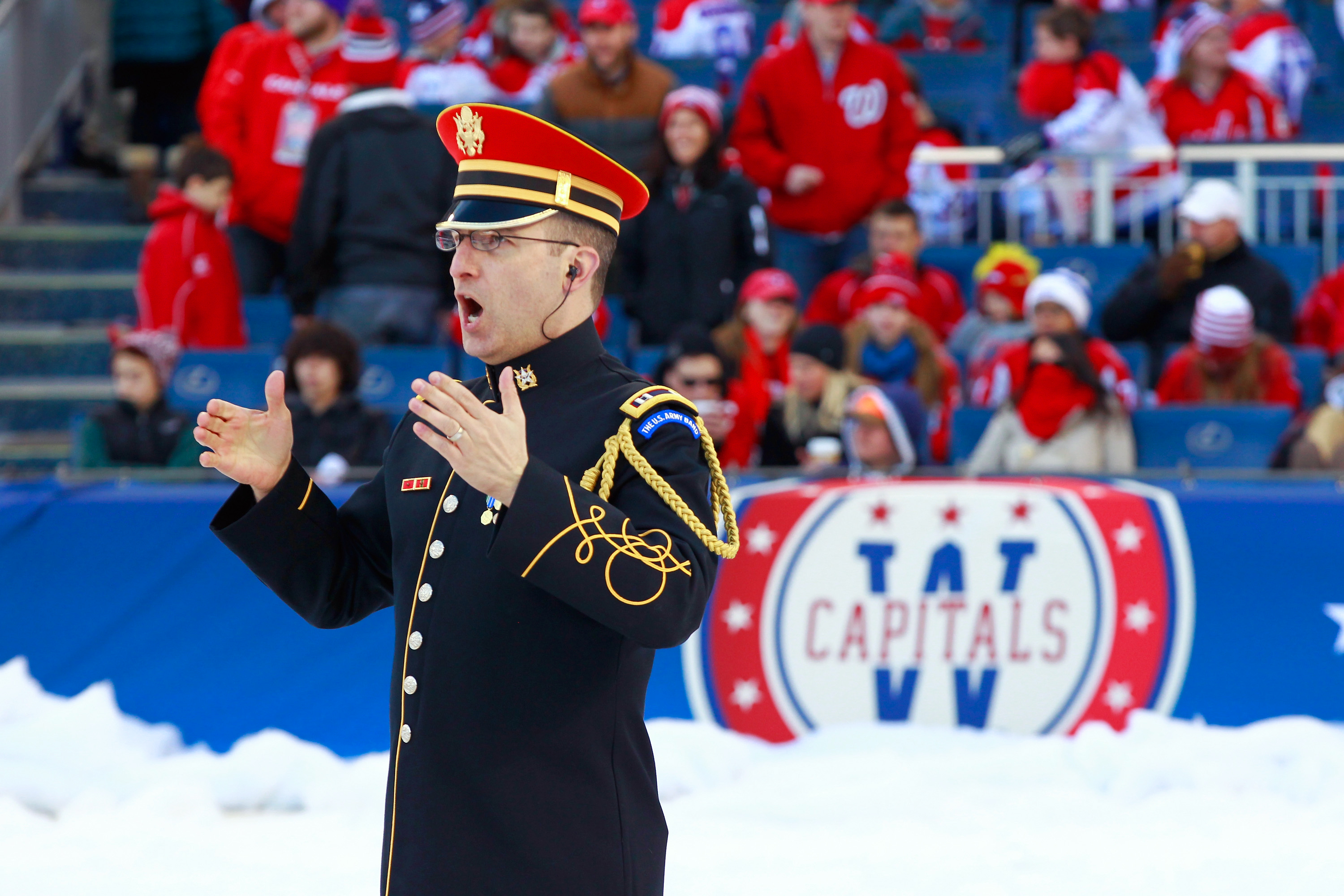 b05997252a2 The U.S. Army Chorus performs during the 2015 Bridgestone NHL Winter  Classic hockey game between the Washington ...