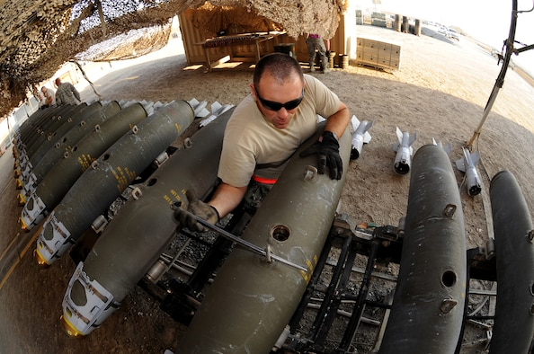 Master Sgt. Adam lines up bomb lugs on MK-82 munitions Dec. 21, 2014, in Southwest Asia, to ensure they are prepared to sync up with aircraft racks during installation. Adam is deployed from Seymour Johnson Air Force Base, N.C. and is the NCO in charge of conventional maintenance. (U.S. Air Force photo/Senior Master Sgt. Carrie Hinson)