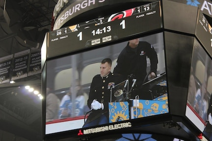Chief Warrant Officer 2 Tony Irene rides the Zamboni during a Pittsburgh Penguins home game on Jan. 31 at the Console Center. The Zamboni rides are done during the intermission of each period of hockey games(Courtesy Photo).