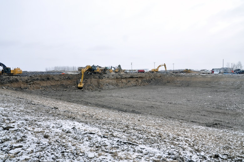 Working up to seven days a week, excavators move 50,000 to 70,000 cubic yards of material a week as contractors work through the winter months to complete the Roseau, Minnesota, flood risk management project.