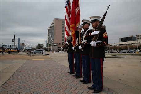 The Recruiting Station Jacksonville Color Guard practices movement January 1, 2015 at the Jacksonville Landing in Jacksonville, Fla., for the 2015 TaxSlayer Bowl game. The Bands on Parade event included the Parris Island Marine Band, marching bands from the Universities of Tennessee and Iowa and high school bands from around the country. The Marine Corps has partnered with the bowl for nine consecutive years. (Official Marine Corps photo by Cpl. John-Paul Imbody)