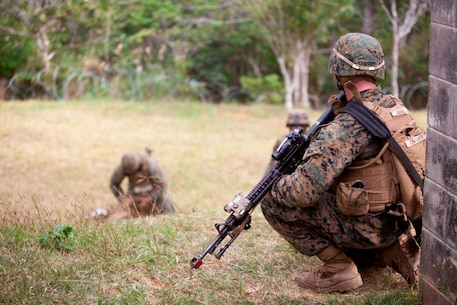 U.S. Marine with Company E, Battalion Landing Team, 2nd Battalion 4th Marines, 31st Marine Expeditionary Unit (MEU), provides security during a vertical assault as part of  the MEU Exercise (MEUEX), in Combat Town, Okinawa, Japan, Dec 10, 2014. BLT 2/4 is conducting training in preparation of their upcoming spring patrol. (U.S. Marine Corps photo by GySgt Ismael Pena/Released)