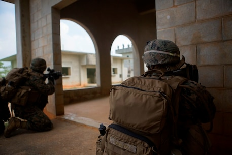 U.S. Marines with Company E, Battalion Landing Team 2nd Battalion, 4th Marines, (BLT) 31st Marine Expeditionary Unit, engage targets while conducting a vertical assault at Combat Town, Okinawa, Japan, Dec. 8, 2014. Company E is conducting training as part of the MEU Exercise and pre-deployment training. (U.S. Marine Corps Photo by Lance Cpl. Richard Currier/ Released)