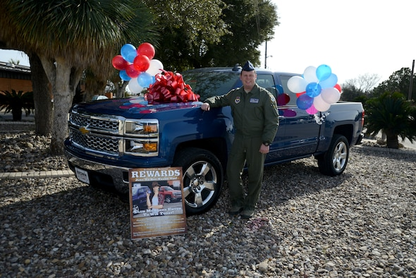 Second Lt. Gary Rogers, a newly graduated pilot from Laughlin's pilot training program, poses next to a 2015 Chevy Silverado outside of Club XL on Laughlin Air Force Base, Texas, Jan. 5, 2015. Rogers won the vehicle in an Air Force Club prize drawing that occurred in December and he was notified of his win Jan. 5 during a commander's call by Col. Brian Hastings, 47th Flying Training Wing commander.  (U.S. Air Force photo by Staff Sgt. Steven R. Doty) (Released)
