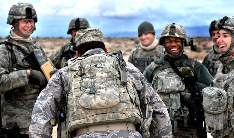Tech. Sgt. Markus Mindoro, 99th Ground Combat Training Squadron integrated base defense course flight chief, jokes with students attending the last 99th GCTS Base Security Operations course at the Silver Flag Alpha Range Complex north of Las Vegas Dec. 17, 2014. The 99th GCTS is set to close in early 2015, and all Air Force tactical security forces-based training will be moved to the new Desert Defender Ground Combat Readiness Training Center at Fort Bliss, Texas. (U.S. Air Force photo by Tech. Sgt. Nadine Barclay/Released)