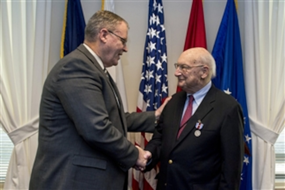Deputy Defense Secretary Bob Work hosts a farewell ceremony for Andrew M. Marshall at the Pentagon, Jan. 5, 2015. Marshall, 93, worked his last day as director of the Defense Department's Office of Net Assessment, retiring after 42 years.