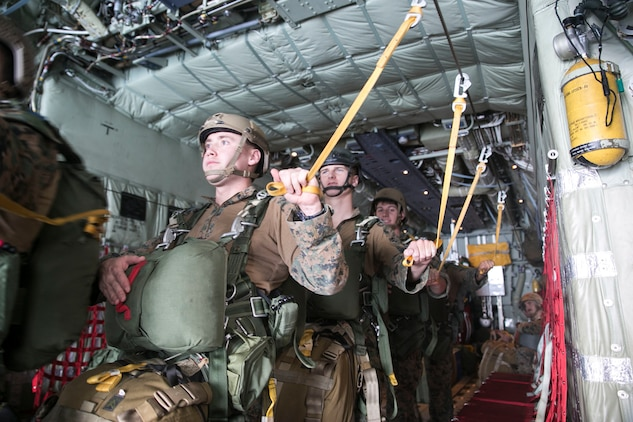 Marines prepare to jump from a KC-130J Super Hercules aircraft Nov. 20, 2014 over Ie Shima Training Facility, off the northwest coast of Okinawa, Japan. The training gave the Marines added experience with air drop operations while also maintaining their jump proficiency. The Marines are with 3rd Reconnaissance Battalion, 3rd Marine