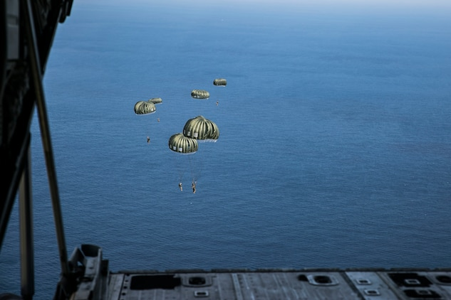 Marines parachute from the back of a KC-130J Super Hercules aircraft Nov. 20, 2014 over Ie Shima Training Facility, off the northwest coast of Okinawa, Japan. The training gave the Marines added experience with air drop operations while also maintaining their jump proficiency. The Marines are with 3rd Reconnaissance Battalion, 3rd Marine Division, III Marine Expeditionary Force.