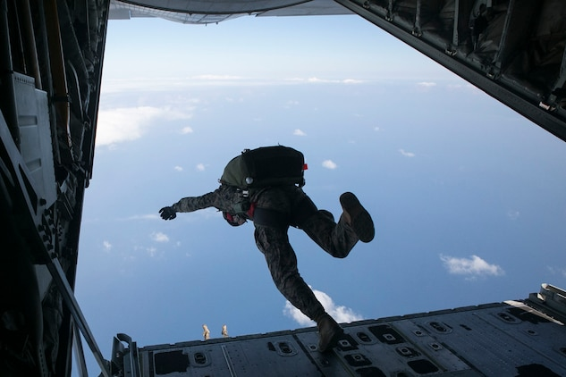 A Marine jumps from a KC-130J Super Hercules aircraft Nov. 20, 2014 over Ie Shima Training Facility, off the northwest coast of Okinawa, Japan. The training helped the Marines stay current with their abilities and helped to increase their confidence jumping. The Marines are with 3rd Reconnaissance Battalion, 3rd Marine Division, III Marine Expeditionary Force.