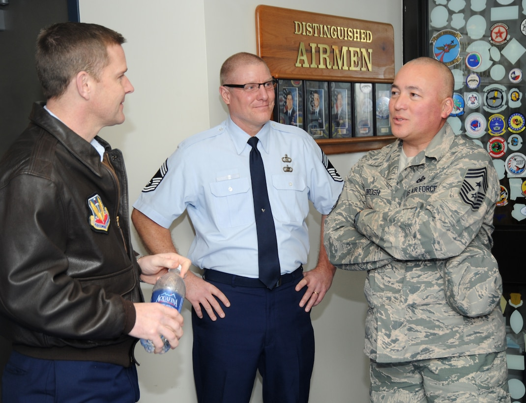 Chief Master Sgt. Mitchell O. Brush, Senior Enlisted Advisor for the National Guard Bureau, right, is greeted by Col. Rick Wedan, 142nd Fighter Wing commander, left, and Chief Master Sgt. David Fry, command post superintendent, assigned to the 142nd Fighter Wing, center, Portland, Ore., Jan. 5, 2015. Chief Brush toured the air base and led a town hall event to highlight the changes and challenges that Soldiers and Airmen of the National Guard face going into the New Year. (U.S. Air National Guard photo by Tech. Sgt. John Hughel, 142nd Fighter Wing Public Affairs/Released)