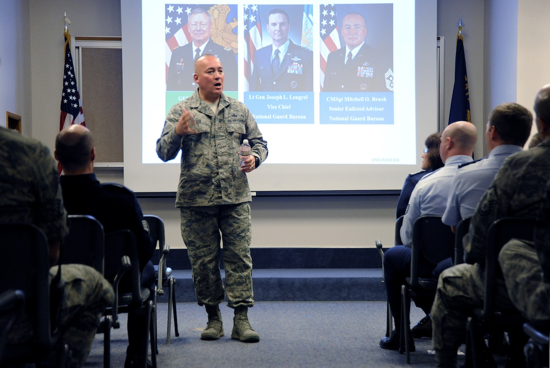 Chief Master Sgt. Mitchell O. Brush, Senior Enlisted Advisor for the National Guard Bureau leads a town hall event at the Portland Air National Guard Base, Ore., Jan. 5, 2015. During the town hall, he addressed the structure of the National Guard Bureau, ongoing changes and challenges that Soldiers and Airmen face going into the New Year. (U.S. Air National Guard photo by Tech. Sgt. John Hughel, 142nd Fighter Wing Public Affairs/Released)