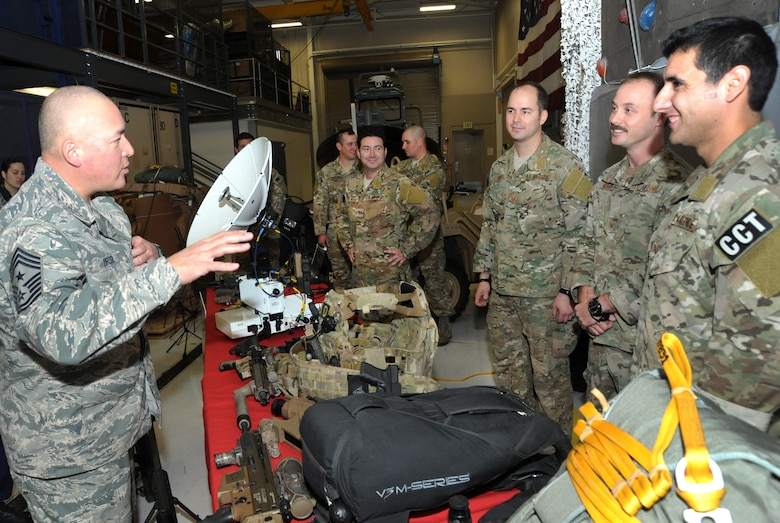 Chief Master Sgt. Mitchell O. Brush, Senior Enlisted Advisor for the National Guard Bureau, left, meets members of the 125th Special Tactics Squadron during his tour of the Portland Air National Guard Base, Ore., Jan. 5, 2015. Chief Brush received a briefing about the 125th mission and some of the unique equipment used by Airmen in the unit. (U.S. Air National Guard photo by Tech. Sgt. John Hughel, 142nd Fighter Wing Public Affairs/Released)