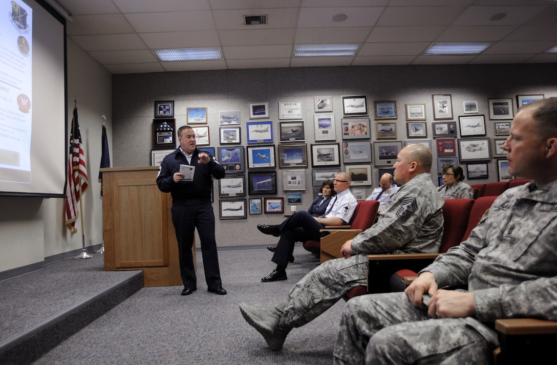 Chief Master Sgt. Christopher Roper, Senior Enlisted Advisor for the Oregon Air National Guard Combat Operations Group (COG), left, gives a brief and overview of the COG mission to Chief Master Sgt. Mitchell O. Brush, Senior Enlisted Advisor for the National Guard Bureau and SGM Shane Lake, Oregon National Guard Senior Enlisted Advisor at the Portland Air National Guard Base, Ore., Jan. 5, 2015. (U.S. Air National Guard photo by Tech. Sgt. John Hughel, 142nd Fighter Wing Public Affairs/Released)