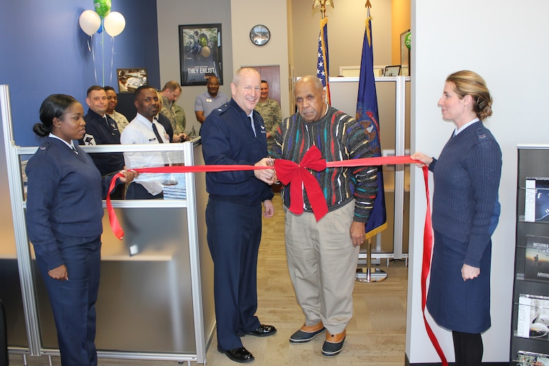 Brig. Gen. John D. Slocum, 127th Wing commander, and Myron Frasier, a member of the Southfield, Mich., City Council, cut the ribbon to open a new Air National Guard recruiting office in Southfield, Jan. 6. 2015. Holding the ribbon are Tech. Sgt. Daquita Hamilton and Tech. Sgt. Maygan Rhodes, both recruiters with the 127th Wing, which is based at Selfridge Air National Guard Base, Mich. (U.S. Air National Guard photo by Tech. Sgt. Dan Heaton