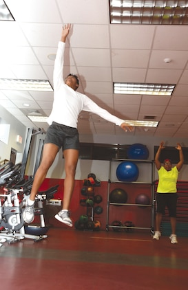 Sgt. Candice Clark-Thomas jumps and touches the ceiling at Daniels Fitness Center, Marine Corps Logistics Base Albany, during a workout session.