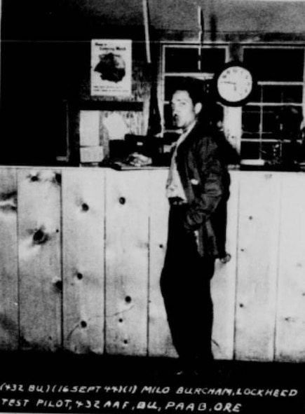 Pictured here is Milo Burcham, Lockheed's ace test pilot, as he stands at the counter of PAAB's operations building.  On September 16, 1944, Burcham, flying a P-38 with incredible ease and skill, put his ship through some of the most difficult maneuvers in flying in a flight over the Portland Army Air Base.  Besides being tremendously exciting, his flight proved to be an invaluable source of inspiration to the pilot trainees of the 432nd Army Air Force Base Unit who would soon be flying P-38's exclusively.  He demonstrated the peak performance that the P-38 could attain.  (U.S. Air Force photo)