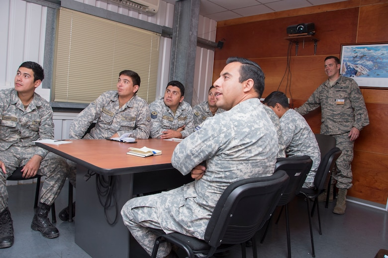 Tech. Sgt. Jeffrey Kelley, 372nd Training Squadron Detachment 12 F-16 Avionics Instructor, presents a power point presentation on the proper use of the technical order to members of the Chilean Air Force on Dec. 01, 2014, while on temporary duty assignment to Chile. Kelley was a member of a three person team, which during their time in Chile was able to visit with members of the Fuerza Aérea de Chile (Chilean air force) and assist in the standing up of a system to be used there. (U.S. Air Force photo by Staff Sgt. Adam Grant/Released)