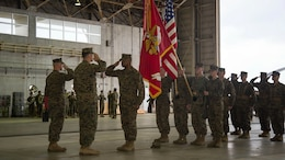 Sgt. Maj. Devon A. Lee, center, salutes Lt. Col. Larry G. Brown and Sgt. Maj. Timonthy J. Rudd during a post and relief ceremony Jan. 8 at hangar 525 on Marine Corps Air Station Futenma, Okinawa, Japan. . Sgt. Maj. Devon A. Lee passes on his reponsibilities as the squadron sergeant major to Sgt. Maj. Timonthy J. Rudd. Marines are with Marine Medium Tiltrotor Squadron 262, 31st Marine Expeditionary Unit.