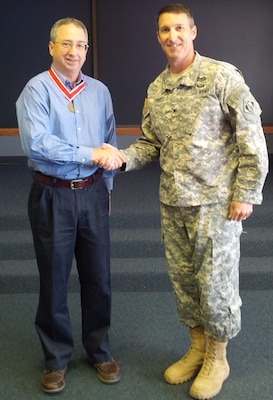 Greg Estep, chief of Hydrology and Hydraulics, Tulsa District, U.S. Army Corps of Engineers was presented with a de Fleury medal by Tulsa District Commander, Col. Richard A. Pratt. Estep began his career with the Corps of Engineers at the Fort Worth District in 1981.