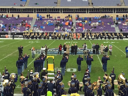Twenty-five men and women took their oath of enlistment during halftime of the Armed Forces Bowl at Amon G. Carter Stadium January 2, 2015.