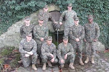 The photo was taken at the reenlistment ceremony.  As you can see, all the Marines are standing at the famous Devil Dog fountain