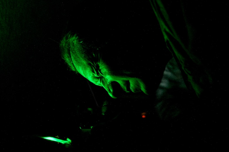 Master Sgt. Jeremy Jacobs does a function check on night vision goggles Dec. 1, 2014, while TDY to Chile. Jacobs was the team lead for a four-week training session that took place in Chile, which focused on perfecting maintenance procedures and the use of night vision goggles. Jacobs is a tactical aircraft manager with the 12th Air Force (Air Forces Southern). (U.S. Air Force photo/Staff Sgt. Adam Grant)