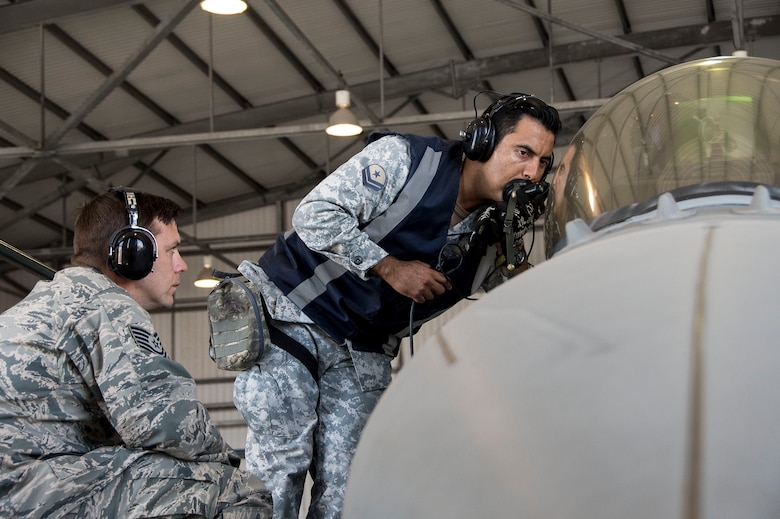 U.S. Air Force Tech. Sgt. Jeffrey Kelley, left, observes while members of the Chilean air force perform preflight functions checks Dec. 3, 2014, in Chile. During the four-week training session, which took place in Chile and focused on perfecting maintenance procedures and the use of night vision goggles, 12th Air Force (Air Forces Southern) members were able to successfully meet all training objectives while establishing a very strong partnership. Kelley is a 372nd Training Squadron Detachment 12 F-16 avionics instructor. (U.S. Air Force photo/Staff Sgt. Adam Grant)