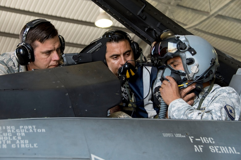 U.S. Air Force Tech. Sgt. Jeffrey Kelley, left, observes while members of the Chilean air force perform preflight functions checks Dec. 3, 2014, in Chile. During a four-week training session in Chile, 12th Air Force (Air Forces Southern) and Chilean air force service members focused on perfecting maintenance procedures and the use of night vision goggles, while establishing a strong partnership. Kelley is an F-16 Fighting Falcon avionics instructor with the Detachment 12, 372nd Training Squadron. (U.S. Air Force photo/Staff Sgt. Adam Grant)