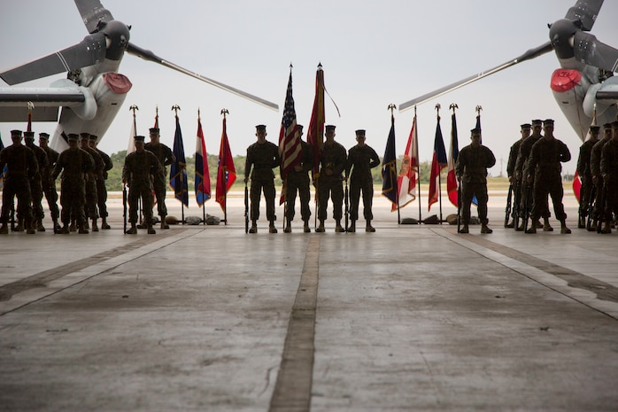 Marines stand at parade rest during a post and relief ceremony Jan. 8 on Marine Corps Air Station Futenma, Okinawa, Japan. Sgt. Maj. Devon A. Lee passed his responsibilities as the squadron sergeant major to Sgt. Maj. Timonthy J. Rudd. The Marines are with Marine Medium Tiltrotor Squadron-262, 31st Marine Expeditionary Unit.