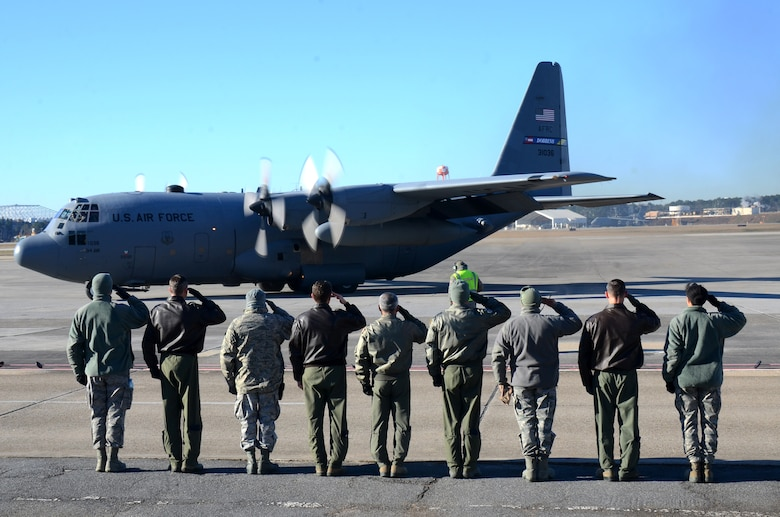 Dobbins Air Reserve Base leadership salute a U.S. Air Force C-130 Hercules as it takes off for a deployment from Dobbins ARB, Ga., Jan. 8, 2015, Ga. More than 150 members from the 94th Airlift Wing deployed to support the Central Command Area of Responsibility. (U.S. Air Force photo/Brad Fallin)