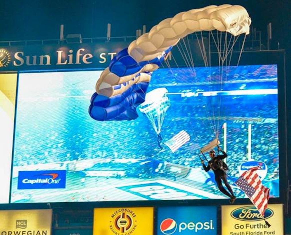 A U.S. Air Force Academy Wings of Blue demonstration team cadet drops into the Orange Bowl Dec. 31, 2014, at Sun Life Stadium in Miami. The Wings of Blue parachute teams were busy training, competing and taking part in a variety of parachute demonstrations across the country during the holiday season. (Courtesy photo)
