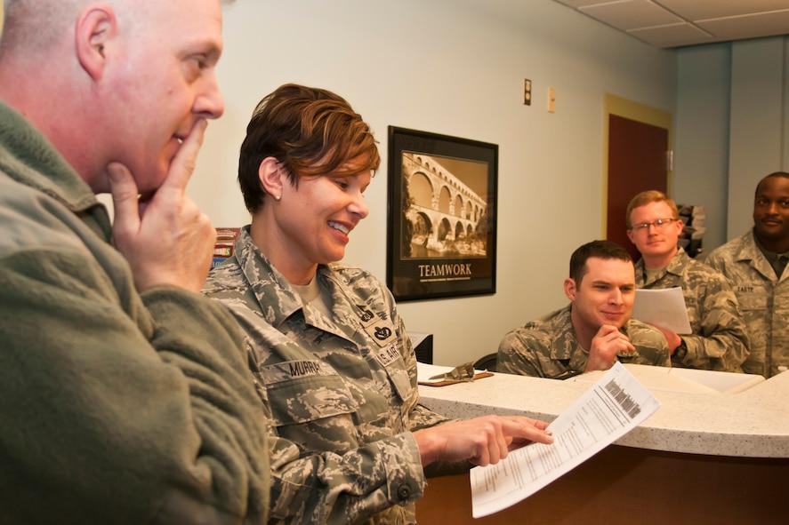 U.S. Air Force Senior Master Sgt. Julie Murray speaks with Airmen, Rickenbacker Air National Guard Base, Ohio, Dec. 13, 2014. (U.S. Air National Guard photo by Airman 1st Class Wendy Kuhn/Released)